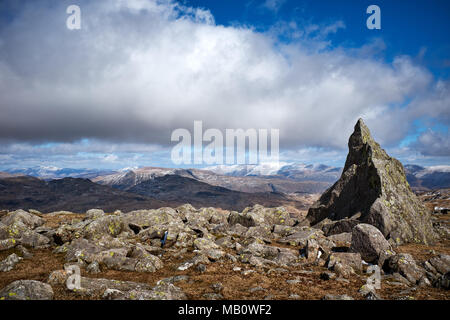 Cumbria / UK - April 5th 2018: The English Lake District where Skiddaw and Helvellyn can be seen from Matterhorn rock on Grey Friar - Stock Photo