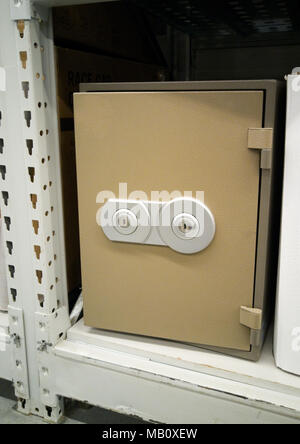 Sale of modern metal safe in the store. - Stock Photo