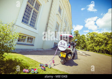 Just married sign and cans on a scooter - Stock Photo