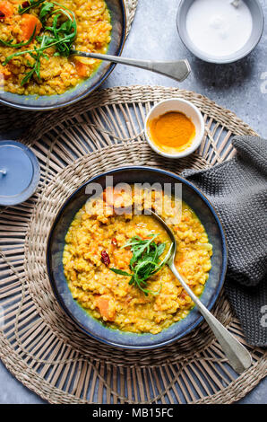 Red lentil and pumpkin soup with turmeric and coconut milk - Stock Photo