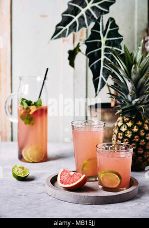 Refreshing ruby red grapefruit and mint juice. - Stock Photo