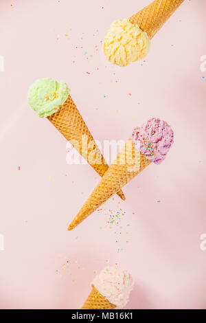 Colorful  Ice Cream in a waffle cones on pink background - Stock Photo