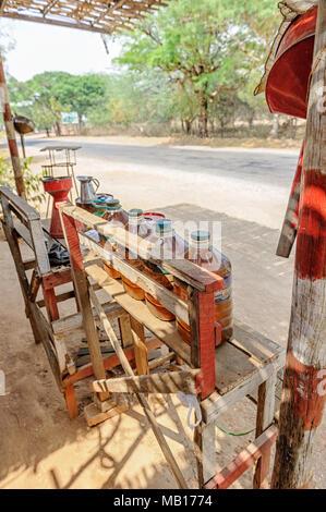 Rural petrol station for motorcycles in Nyaung U, Mandalay Region, Myanmar (Burma) - Stock Photo