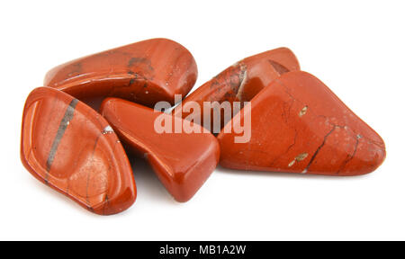 Close-up of five tumbled red jasper gemstones on white background - Stock Photo