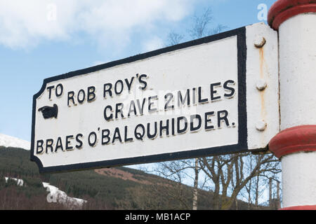 cast iron victorian signpost pointing towards Rob Roy's Grave and Braes O'Balquhidder, Balquhidder, Scotland, UK - Stock Photo
