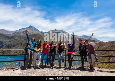 Cotacachi, Ecuador, October 13, 2017: A group of mountain climbers celebrate the beginning of the trek around the Cuicocha lagoon - Stock Photo