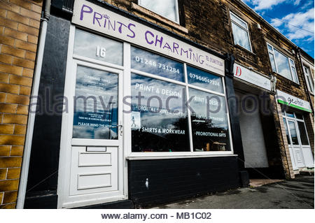 Prints Charming a small unusual named print & design shop on the High Street using a play on words as its title in Holmewood, Chesterfield England UK - Stock Photo