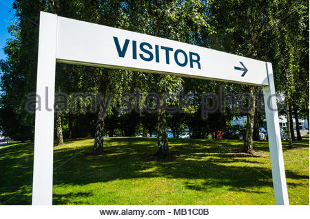 Visitor sign & arrow point direction to the BMW Group UK Ltd Group Vehicle Distribution Centre entrance sign for Mini & BMW in Thorne, Doncaster UK - Stock Photo