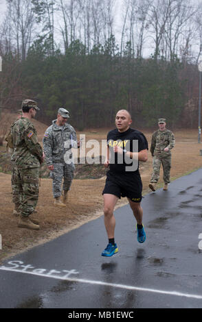 Army Sgt. Betuel Moneje, assigned to the 42nd Civil Support Team, approaches the finish line of the 2-mile-run event of the Army Physical Fitness during the 60th Troop Command's (60th TC) Best Warrior Competition in Raleigh, North Carolina, Feb. 10, 2018. The two-day competition tested the mental and physical strength of seven Soldiers, with one enlisted and one noncommissioned officer being selected to represent 60th TC during the state-level completion in March. - Stock Photo