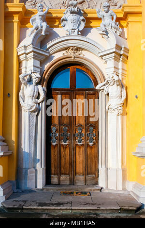 Richly ornamented door with cupids and atlants at the baroque Wilanow Royal Palace. WARSAW, POLAND - JANUARY 13, 2008 - Stock Photo
