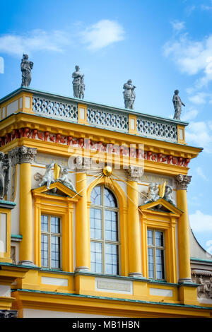 Wilanow Royal Palace central yellow facade part architectural details with golden Sun rays WARSAW, POLAND - SEPTEMBER 13, 2009 - Stock Photo