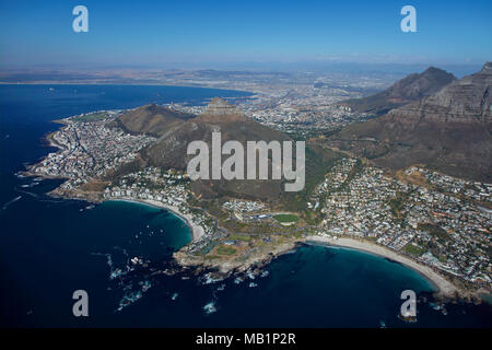 Clifton Beach (left), Camps Bay (right), and Table Mountain, Cape Town, South Africa - aerial - Stock Photo