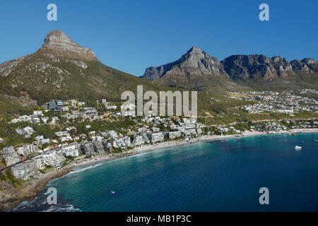 Luxury apartments, Clifton Beach, Lion's Head, and Table Mountain, Cape Town, South Africa - aerial - Stock Photo