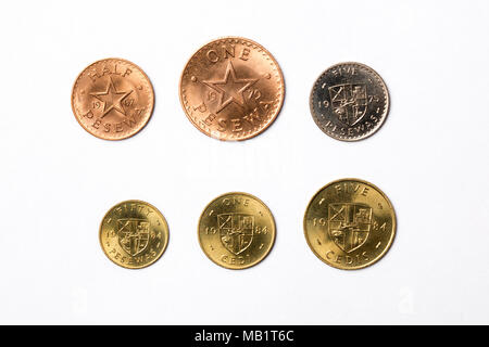 Coins from Ghana on a white background - Stock Photo