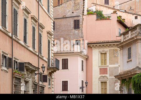 Old town buidlings in the streets of Rome, Italy near to the Pantheon. Some have been restored recently and have artistic paintings on them. - Stock Photo