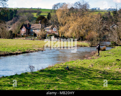 Peak District National Park. 5th Apr, 2018. UK Weather: fly fisherman enjoying the glorious sunshine on Thursday after the wet Easter Bank Holiday break at Ashford on the Water, near Bakewell in the Peak District National Park Credit: Doug Blane/Alamy Live News - Stock Photo