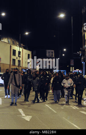Marchers from the grassroots community organisation, GANG (Guiding A New Generation) along Morning Lane, Hackney, London, United Kingdom.  The demonstration follows the death on Wednesday (04.04.2018) of 18-year-old Israel Ogunsola who was stabbed to death and died in Link Street, Hackney. Police found him wounded after they were alerted by a motorist just before 8.00pm.   He was given first aid by police officers, but died at the scene at 8.24pm. He was initially thought to be aged in his 20s.  GANG is a youth outreach movement which focusses on the black community and implores young men in t - Stock Photo