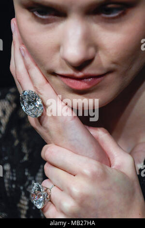 London, UK.  6 April 2018. A model presents a 50.39-carat oval diamond (top) and a 51.71-carat round brilliant-cut diamond (bottom) at a photocall at Sotheby's, New Bond Street. They are two of the largest, purest white diamonds ever to come to auction, have a combined estimate in excess of US$15m and will be sold at auction in Geneva on 15 May.  Credit: Stephen Chung / Alamy Live News - Stock Photo