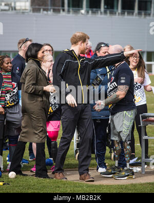 Bath, UK. 6th April, 2018. Prince Harry and Meghan Markle  at the University of Bath University Sports Training Village attending the UK team trials for the 2018 Invictus Games. This year's Invictus Games will be held in Sydney, Australia in October 2018 Credit: David Betteridge/Alamy Live News - Stock Photo