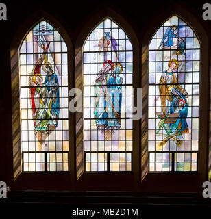 Saint Louis, United States-March 11, 2015: Stained glass window by Emil Frei Jr. at St. Gabriel the Archangel - depicts holy family, angel Gabriel - Stock Photo