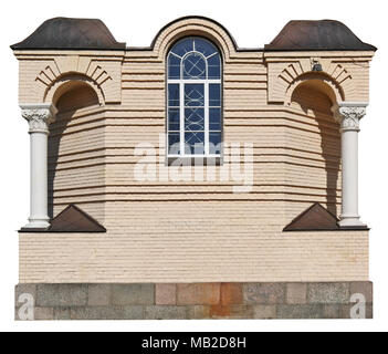 This is the standard decoration of the window of the old Orthodox church - a yellow brick wall with plaster columns. Isolated  with patch sunny day ou - Stock Photo