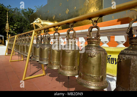 row of bells at the golden pagoda Chedi of temple Wat Phra Singh, Chiang Mai, Thailand - Stock Photo