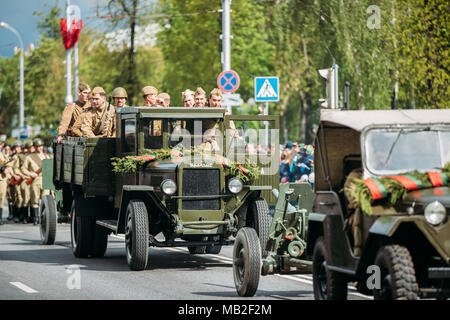 Gomel, Belarus - May 9, 2017: Group Of Re-enactos Dressed As Russian Soviet Soldiers Of World War II Sitting In Truck ZIS-5V And Taking Part In Parade - Stock Photo