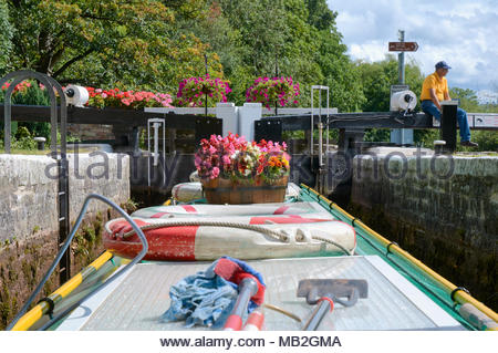 A narrowboat on the brecon monmouth canal in the brecon beacons national park in wales uk - Stock Photo