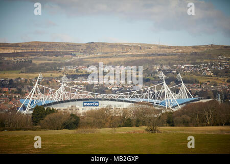 BWFC - Exterior of Bolton Wanderers FC Macron Stadium with Winter Hill behind - Stock Photo