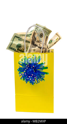 Vertical shot of a yellow gift bag with blue bow that is full of money.  Isolated on White.  Copy Space. - Stock Photo