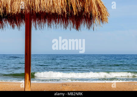 Sunshade on the beach by the sea for tourists - Stock Photo