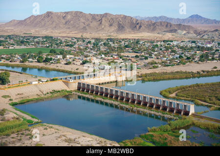 THE END OF THE COLORADO RIVER AT THE DIVERSION DAM OF MORELOS (aerial view). At the international border between Los Algodones in Mexico and the USA. - Stock Photo
