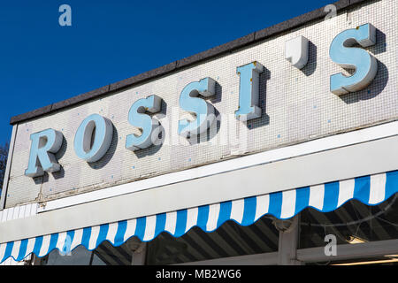 ESSEX, UK - APRIL 5TH 2018: The logo above the Rossis Ice Cream Parlour at Westcliff on the Southend seafront in Essex, UK, on 5th April 2018. - Stock Photo