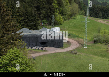 A World War Two concrete Old  german bunker  with the  electric poles and wires in background. Czech republic, europe - Stock Photo