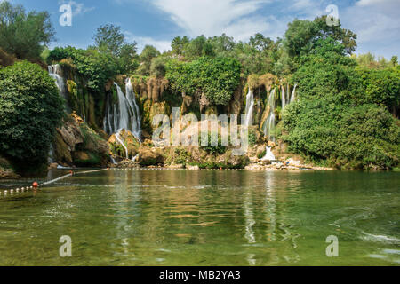 Popular Kravica Or Kravice Waterfall A Large Scenic Tufa Cascade On The Trebižat River, In The Karstic Heartland South Of Bosnia And Herzegovina Near  - Stock Photo