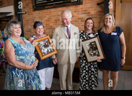The Prince of Wales meets four sisters he boarded with when he was 17, in Geelong, Victoria where he went to school, (Left to right) Penny Jenner, Jane Tozer, Amanda Boxhall and Lisa Lawlor during a tour of the Bundaberg Rum Distillery. - Stock Photo
