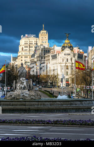 Plaza de Cibeles square and Calle de Alcala street with Metropolis Building or Edificio Metropolis in the background, Madrid, Spain - Stock Photo