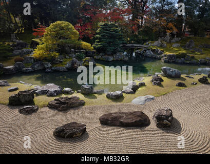Traditional Japanese Zen rock garden with a pond and white pine trees, Sanbo-in, Sanboin Buddhist temple, Daigo-ji temple - Stock Photo