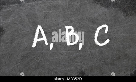ABC written in chalk on blackboard - Stock Photo