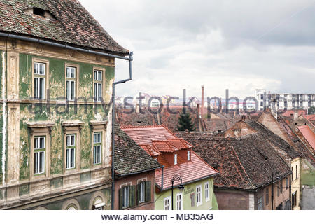 A view of the traditional buildings, streets and across the rooftops of Sibiu, a Romanian town in Eastern Europe. - Stock Photo