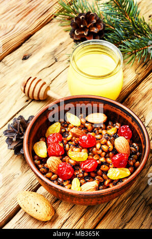 national Russian Christmas dish, a porridge with raisins and almonds, kutya - Stock Photo