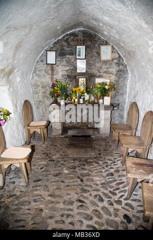 View inside the chapel of Saint Trillo, the smallest chapel in Britain at Rhos on Sea North Wales - Stock Photo