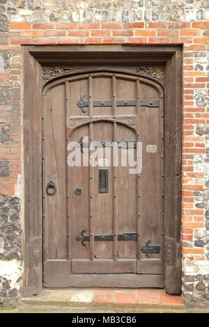 NORWICH, UK - MARCH 30, 2018: Details of the door of a timbered framed House located on Colegate and built by Henry Bacon in 16th Century - Stock Photo