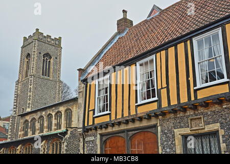 NORWICH, UK - MARCH 30, 2018: A timbered framed House (located on Colegate and built by Henry Bacon in 16th Century) with St George Colegate Church - Stock Photo