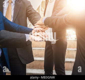 Business teamwork join hands support together and dedicated Concept - Stock Photo