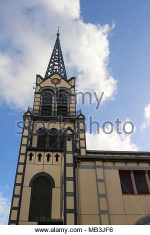 The tower of the beautiful St Louis cathedral in Fort-de-France, Martinique - Stock Photo