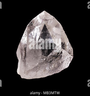 Rough quartz crystal on black background. With pyramid shaped optical illusion inside the mineral. Semi precious gemstone. Silica, silicon dioxide. - Stock Photo