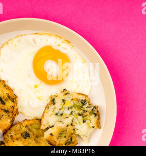 Fried Egg on a Plate With Bubble and Squeak Patties Meal - Stock Photo