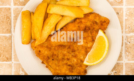 Traditional Popular Fish And Chips On A Tiled Kitchen Table Top - Stock Photo