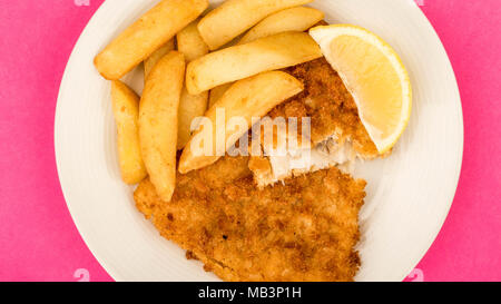 Traditional Popular Fish And Chips Against A Pink Backgound With A Slice Of Lemon - Stock Photo
